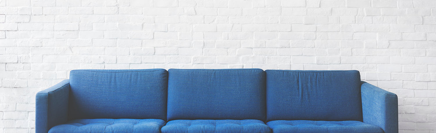 white walls and a blue sofa